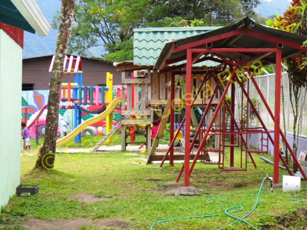 This large yard with playground equipment is a great place for the kids to play.