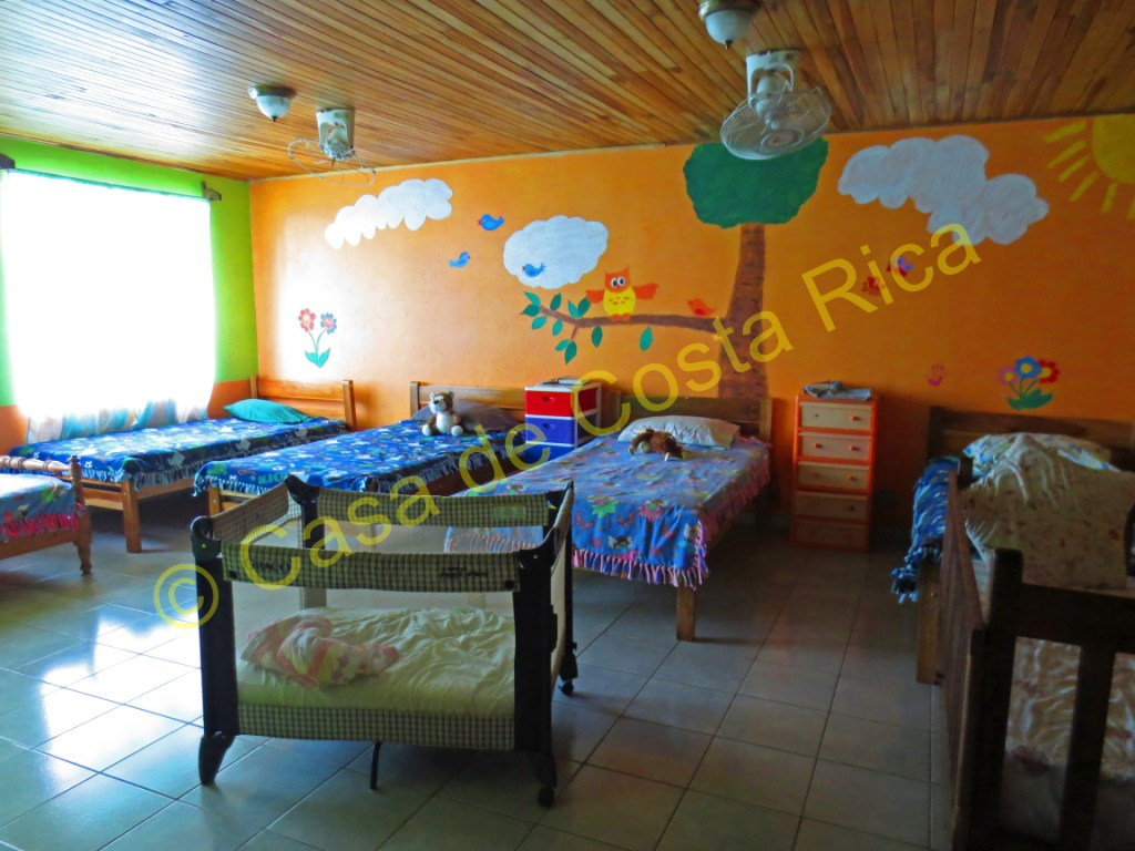 Large bedroom of the kids with colorful murals.