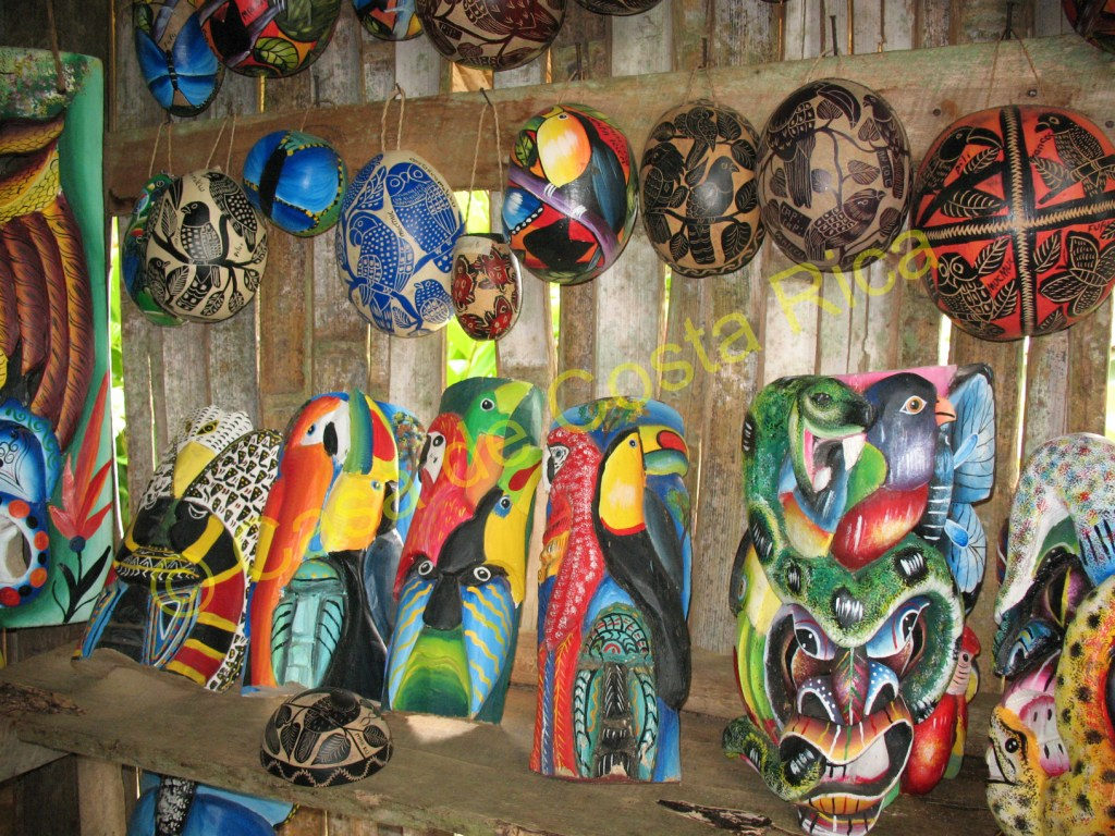 Their balsa wood masks and gourd artwork are available for purchase.