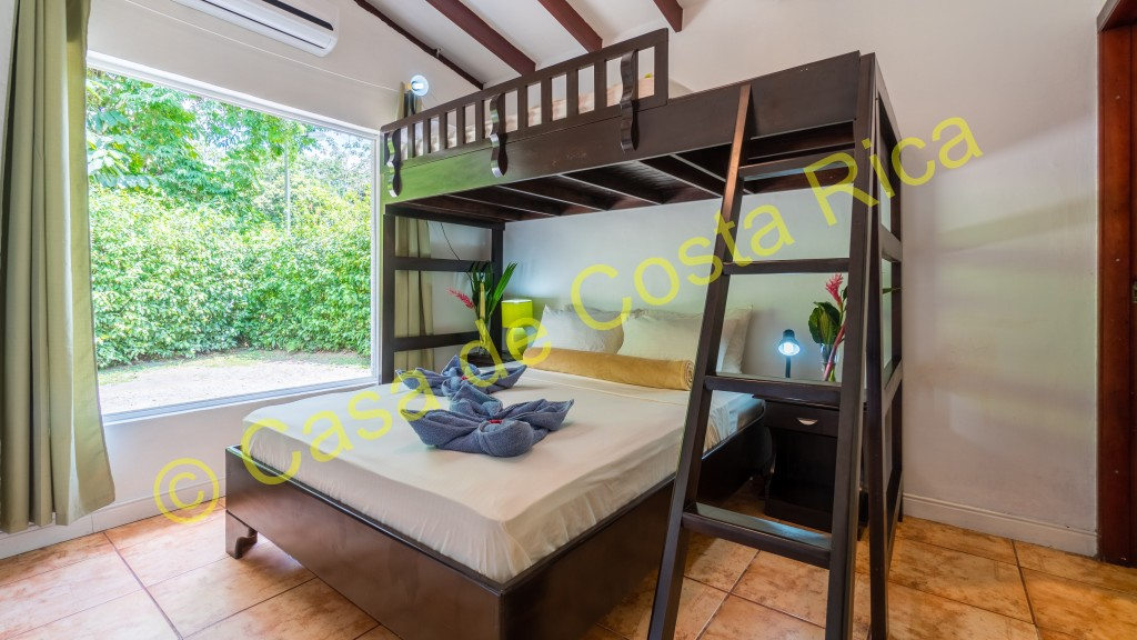 Second bedroom with queen bed and single top bunk, and ensuite bathroom.