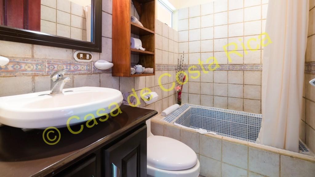 Second bedroom ensuite bathroom with tub.